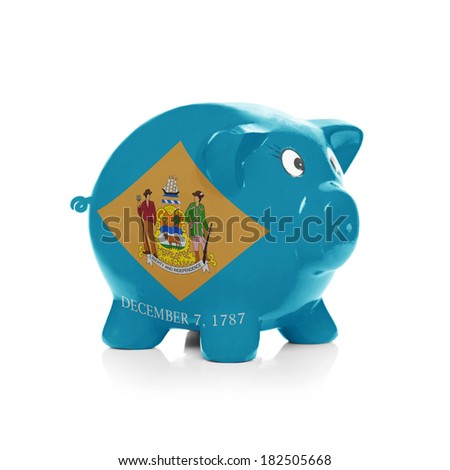 Piggy bank with flag coating over it isolated on white - State of Delaware - stock photo