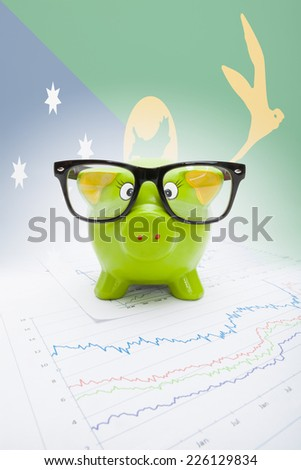 Piggy bank with flag on background series - Christmas Island - stock photo