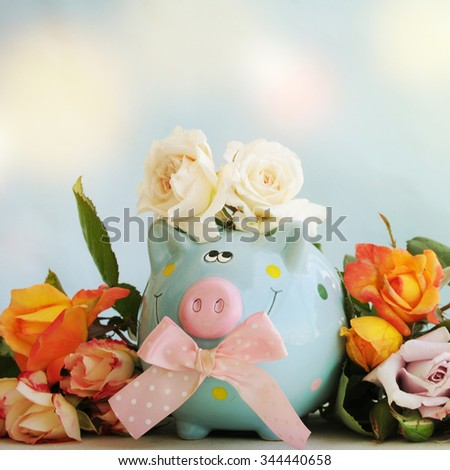 Piggy bank with flowers. Gift for Mothers Day - stock photo