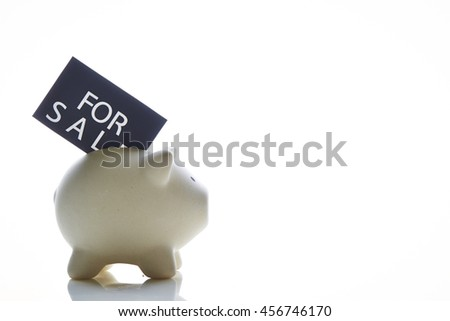 Piggy bank with for sale tag