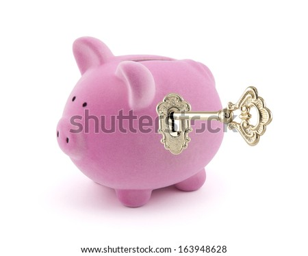 Piggy bank with golden key - stock photo