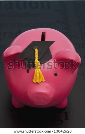 Piggy bank with graduation cap – cost of education - stock photo