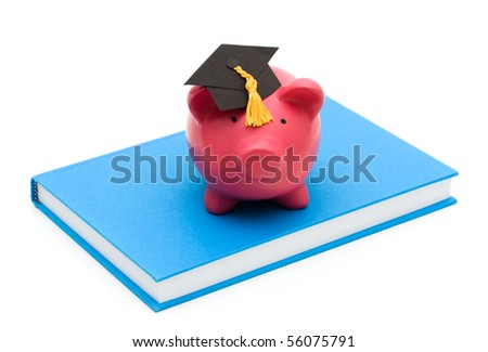 Piggy bank with graduation cap on a book isolated on a white background, education savings - stock photo