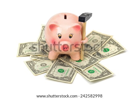 piggy bank with hammer on dollar pile