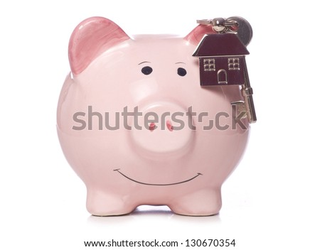piggy bank with house keys and keyring studio cutout - stock photo