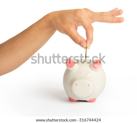 Piggy bank with humans hand on isolated white background, close up view