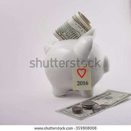 Piggy bank with I love 2016 post it note and money - stock photo