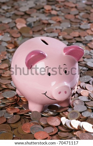 piggy bank with money background in studio - stock photo