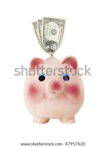 Piggy bank with money. Includes clipping path.