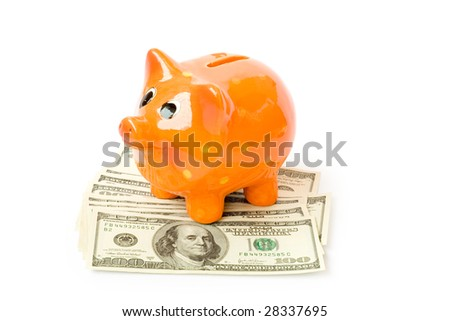 piggy bank with money isolated on white