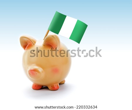 Piggy bank with national flag of Nigeria - stock photo