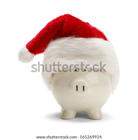 Piggy Bank With Santa Hat Isolated on White Background. - stock photo