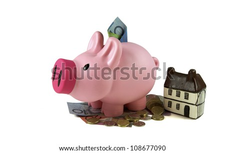 Piggy bank with savings, Finance - stock photo