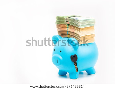 Piggy bank with stack of euro banknotes bills and car home key isolated on white background. Financial success idea concept. Real estate transportation debt burden   - stock photo