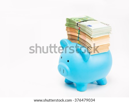 Piggy bank with stack of euro banknotes bills isolated on white background. Financial success idea concept   - stock photo