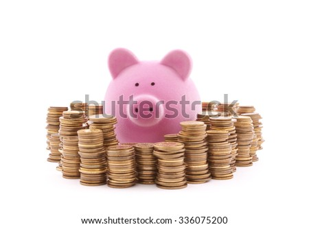 Piggy bank with stacks of coins. Clipping path included.  - stock photo