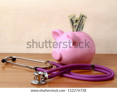 Piggy bank with stethoscope isolated on white concept for financial checkup or saving for medical insurance costs - stock photo