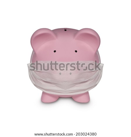 piggy bank with surgical mask as a symbol for medical expenses - health care - stock photo