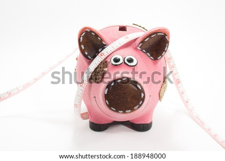 piggy bank with tapeline - stock photo