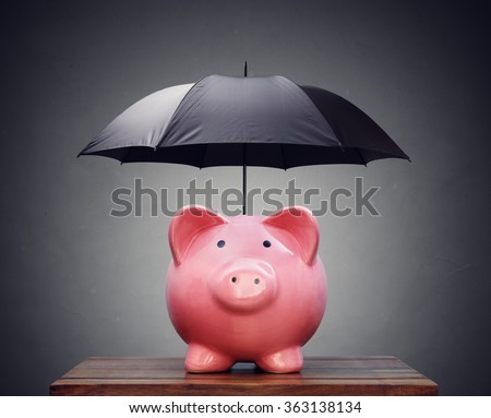 Piggy bank with umbrella concept for finance insurance, protection, safe investment or banking - stock photo