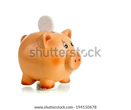 Piggy bank with white tablet on the back over white background