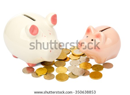 Piggy banks with coins on isolated white background