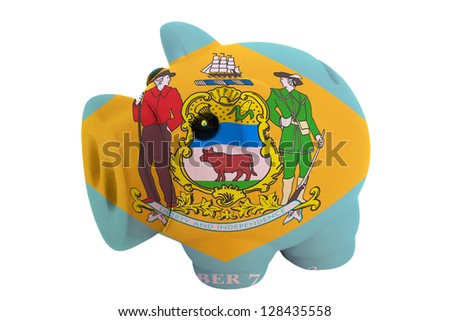 piggy rich bank in colors flag of us state of delaware for savings on white background - stock photo
