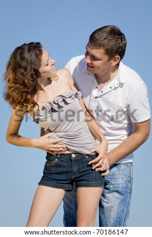 Piggyback. Attractive couple playing outdoors