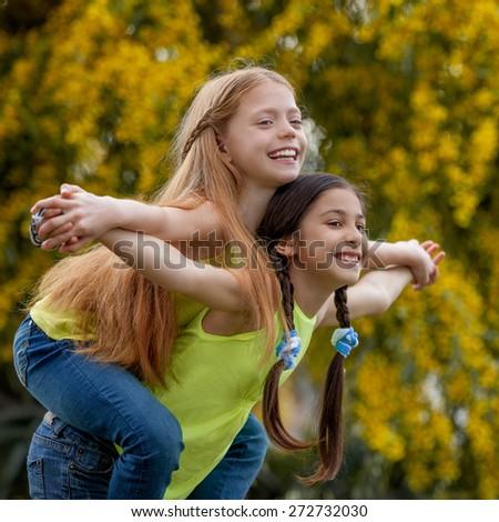 piggyback  happy healthy smiling summer kids - stock photo
