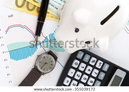 Piggybank and fountain pen with calculator