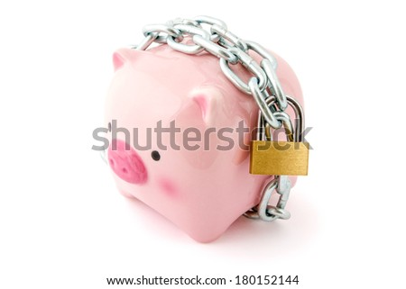 Piggybank chained up and locked. Concept for financial protection inferences or other investment messages.  - stock photo