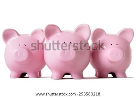 Piggybank savings : Row of piggy banks isolated on white. - stock photo