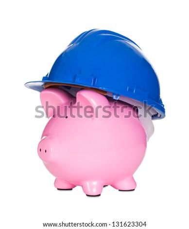 Piggybank wearing construction helmet. Isolated on white - stock photo