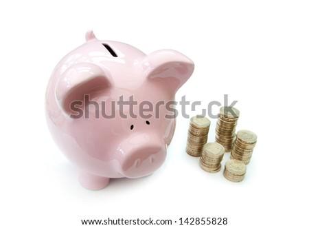 Piggybank with coins - stock photo