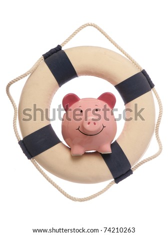 Piggybank with safety life ring studio cutout - stock photo