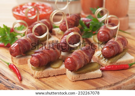 Pigs in blankets, baked bacon and sausage rolls - stock photo