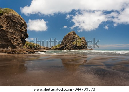 Piha beach in New Zealand at low tide