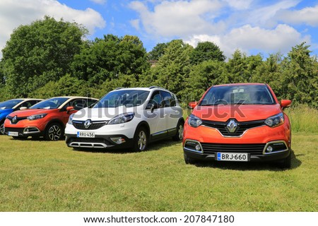 PIIKKIO, FINLAND - JULY 19, 2014: Red Renault Captur Cars and a White Scenic Xmod on display. Renault Captur wins its category in the influential Tow Car Awards 2014. - stock photo