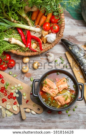Pike and fresh vegetables for soup of fish - stock photo