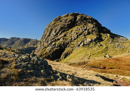 Pike of Stickle, mountain above Great Langdale in the English Lake District, on a sunny autumn day - stock photo