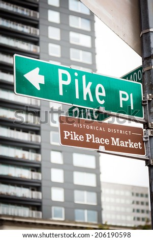 Pike Place Market street sign at the famous marketplace, Seattle's first farmer's market and home to the original Starbucks coffee shop. - stock photo