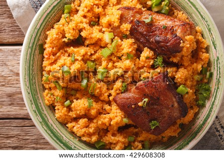Pilaf bulgur and beef close-up on a plate on the table. horizontal view from above