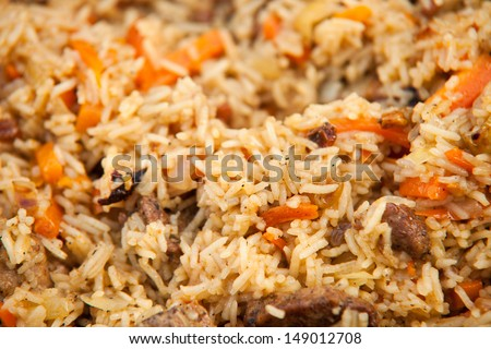 Pilaf (Plov) - Afghan, Uzbek, Tajik national cuisine main dish - stock photo