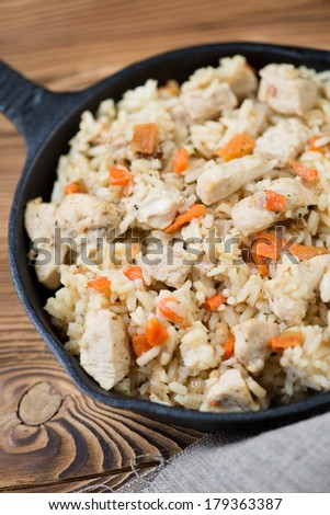 Pilaf with chicken, close-up, vertical shot