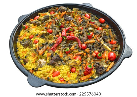 Pilaf with meat, spices, garlic and red pepper, cooked over a fire in a cast iron cauldron. Isolated on white background - stock photo