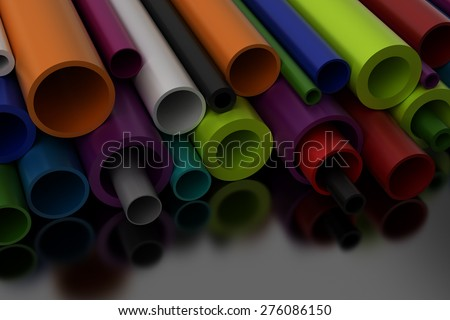 Pilastic Pipes on black background - stock photo