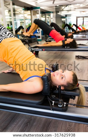Pilates  woman in reformer device doing butt exercise