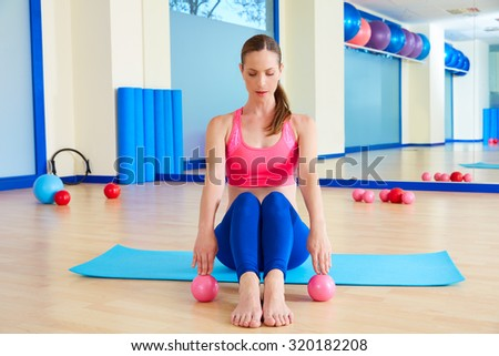 Pilates woman sand balls exercise workout at gym indoor - stock photo
