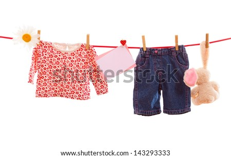 Pile baby clothes isolated