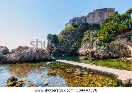 Pile Bay near Dubrovnik old town with fortress Lovrijenac - stock photo